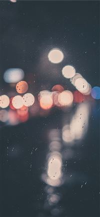bokeh photography of clear glass panel with light iPhone 11 wallpaper