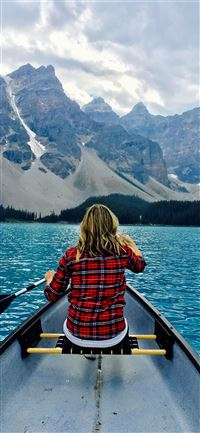 brown haired woman riding boat during day time iPhone 11 wallpaper