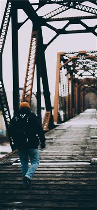 person waling on bridge iPhone 11 wallpaper
