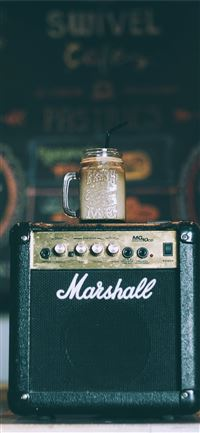 black Marshall guitar amplifier with glass mug on ... iPhone 11 wallpaper