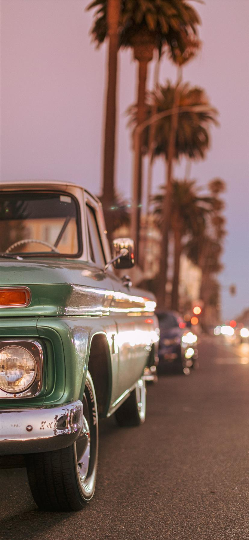 Vintage car parked on Ocean Blvd during sunset  iphone 11 wallpaper