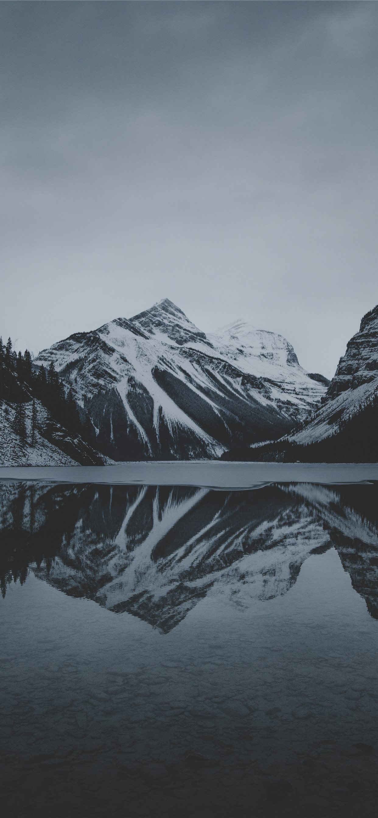 Snow Mountains And Lake Undr Gray Sky Iphone Wallpapers Free Download