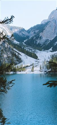 blue calm lake by the icy mountain iPhone 11 wallpaper