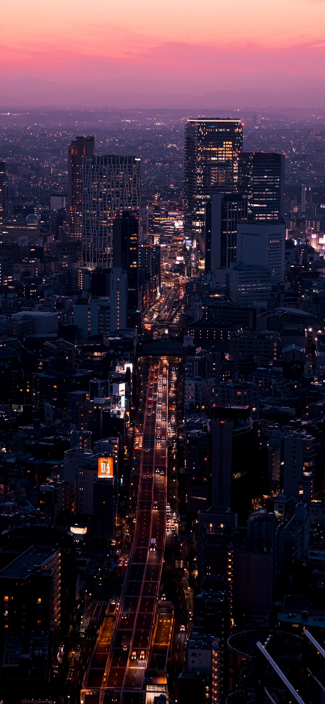 Aerial View Of City Buildings During Night Time Iphone 12 Wallpapers Free Download