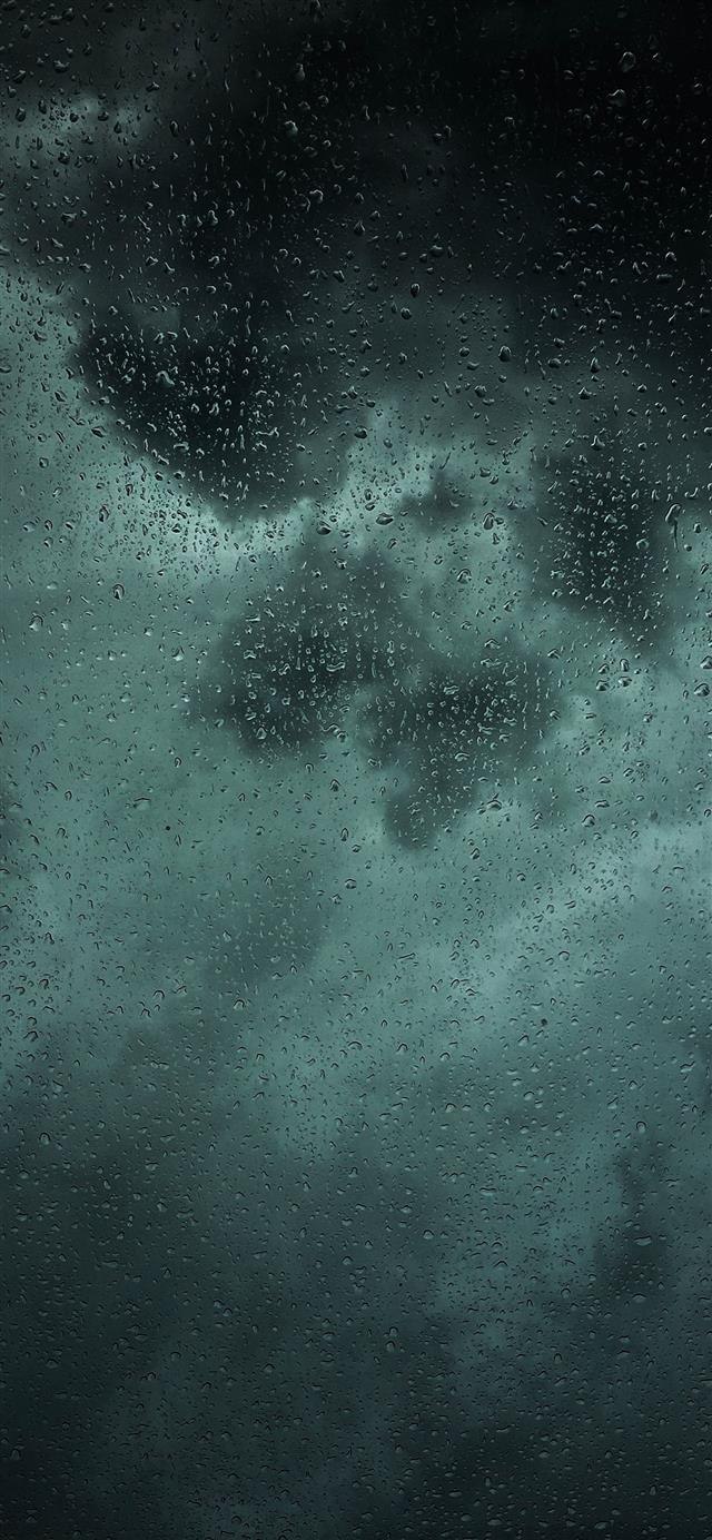 dew drops on glass panel iPhone 12 wallpaper