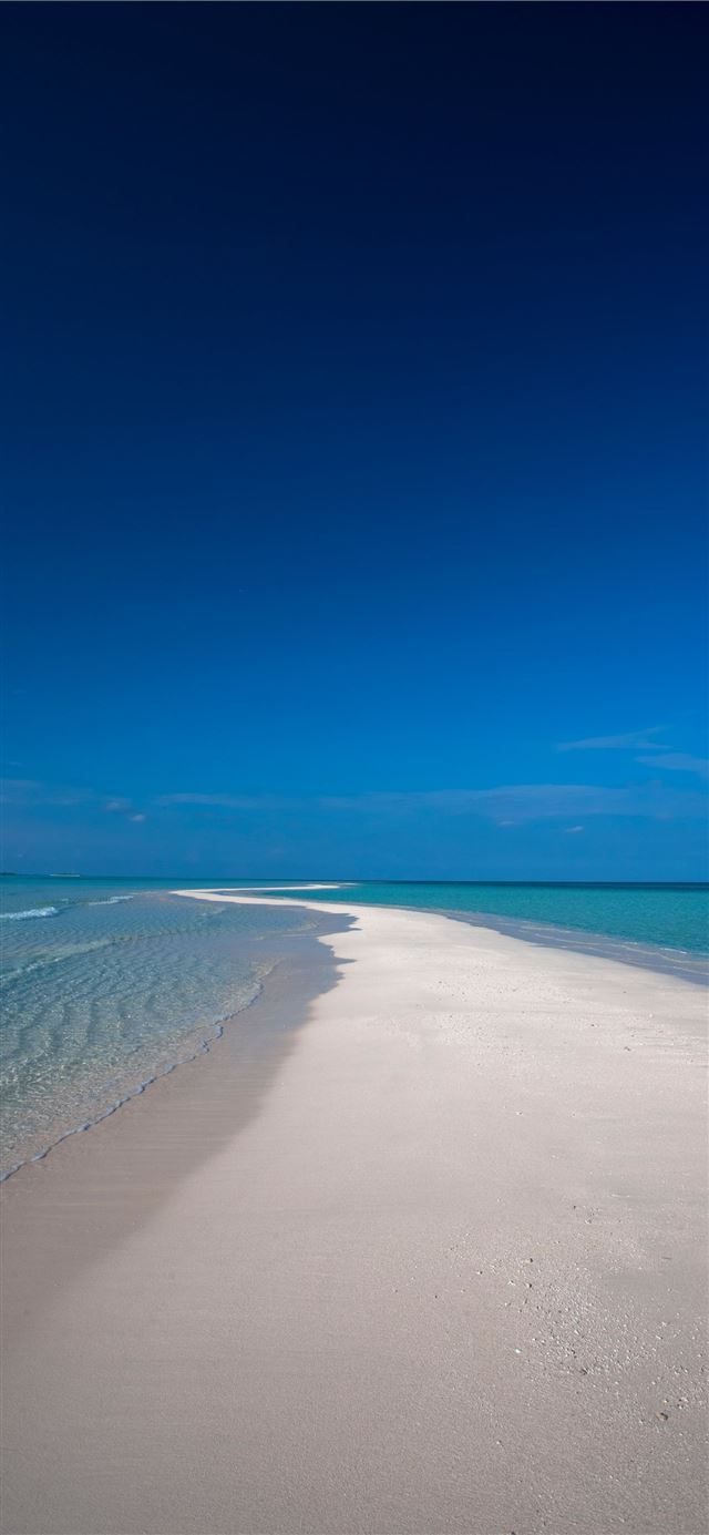 beach sand during daytime iPhone 12 wallpaper