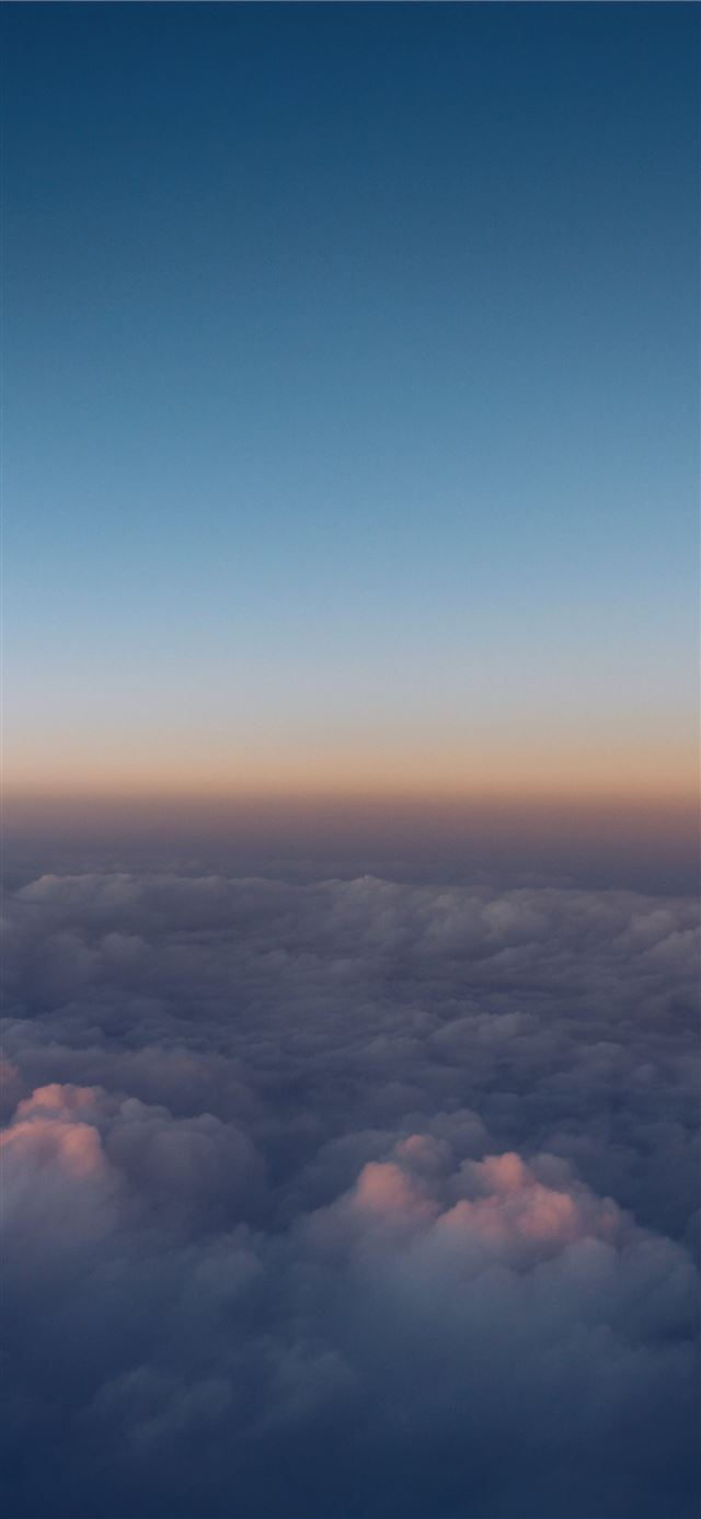 photo of white clouds iPhone 12 wallpaper
