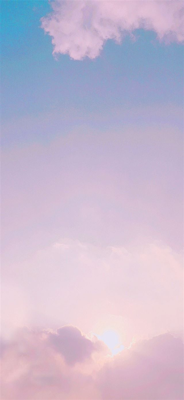 photo of pink and blue clouds iPhone 12 wallpaper