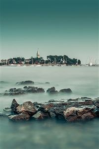 Foggy island sea iPhone 4s wallpaper