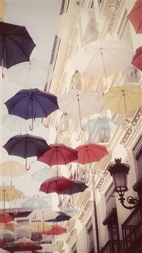 Floating Colorful Umbrellas In City iPhone 6(s)~8(s) wallpaper