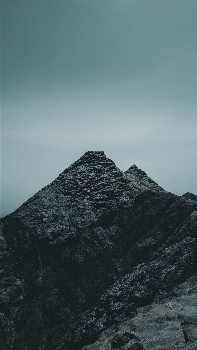 rock mountain under cloudy sky iPhone wallpaper