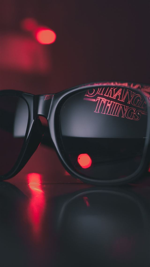 black wayfarer sunglasses on black surface iPhone wallpaper