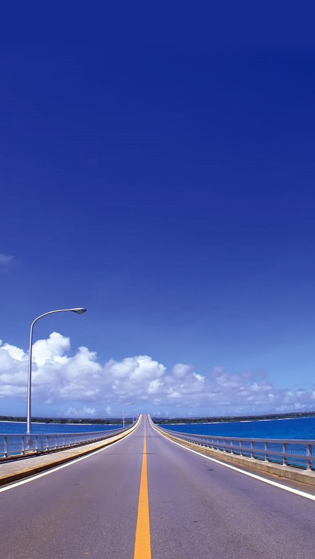 Blue skies and road iPhone wallpaper