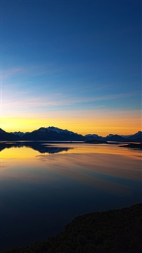 Sunset over mountain lake iPhone 5s wallpaper