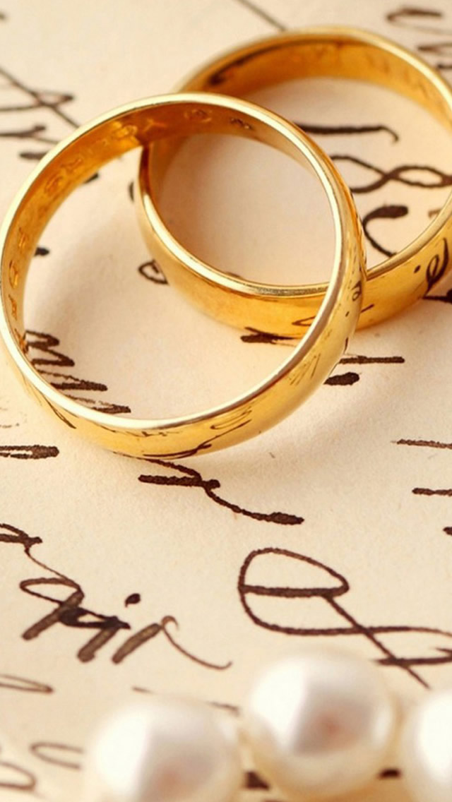 Love Romance Ring Pair On Book iPhone wallpaper
