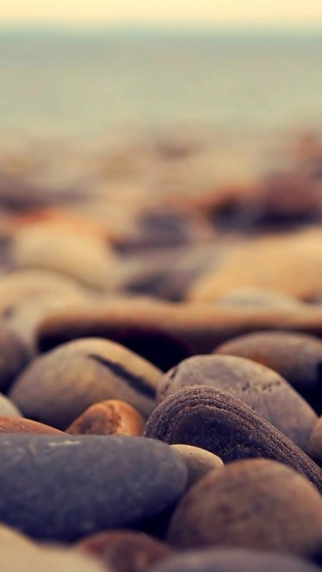 Ocean Beach Pebble Rocks Blur iPhone wallpaper