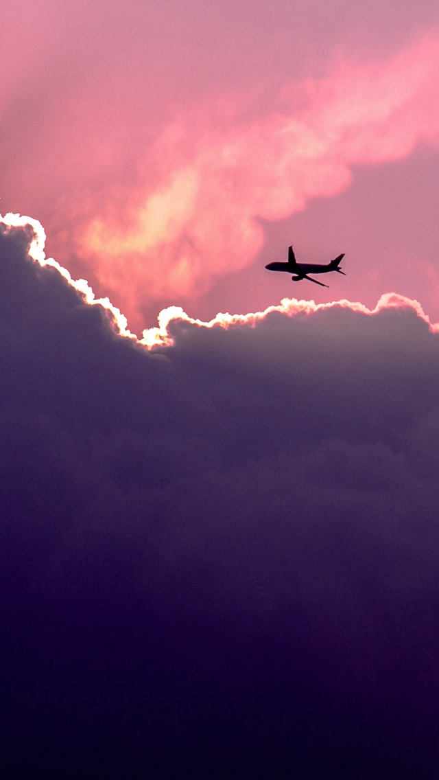 Plane Above Sunset Clouds iPhone wallpaper