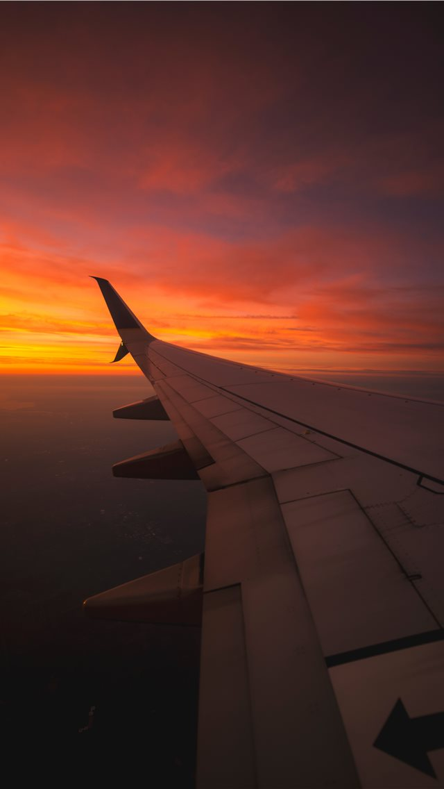 Sunset View From the Window of an Airplane iPhone wallpaper