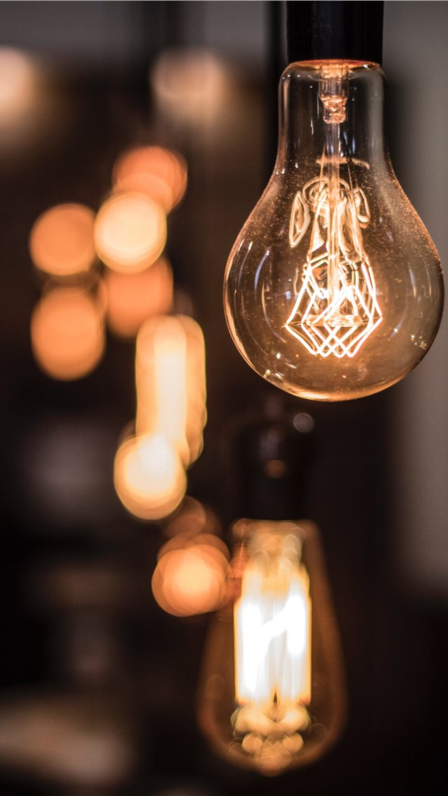 Vintage lightbulb inside a coffee shop in Mexico C... iPhone wallpaper