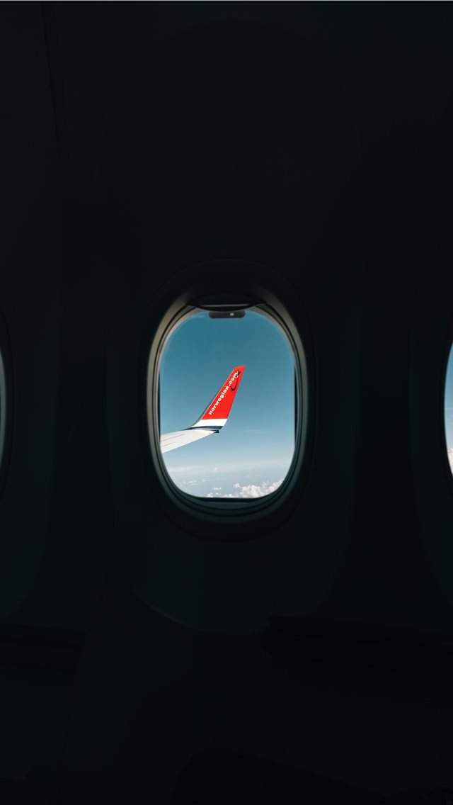 red airplane wing through window iPhone wallpaper