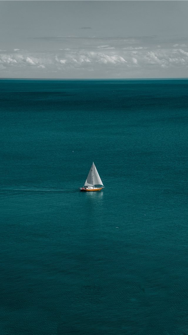 white and brown boat in body of water iPhone wallpaper
