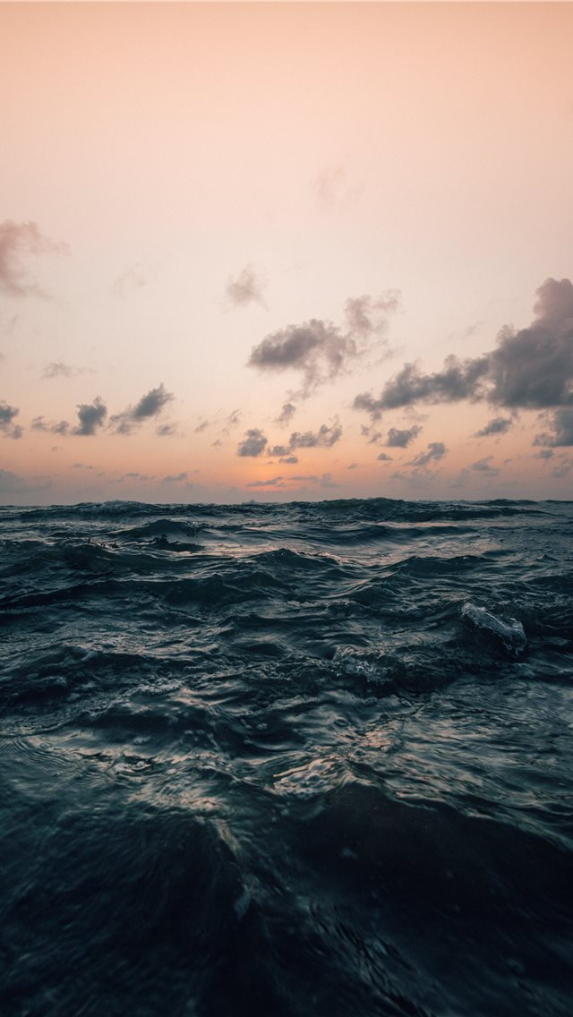 sea under cloudy sky in nature photography iPhone wallpaper