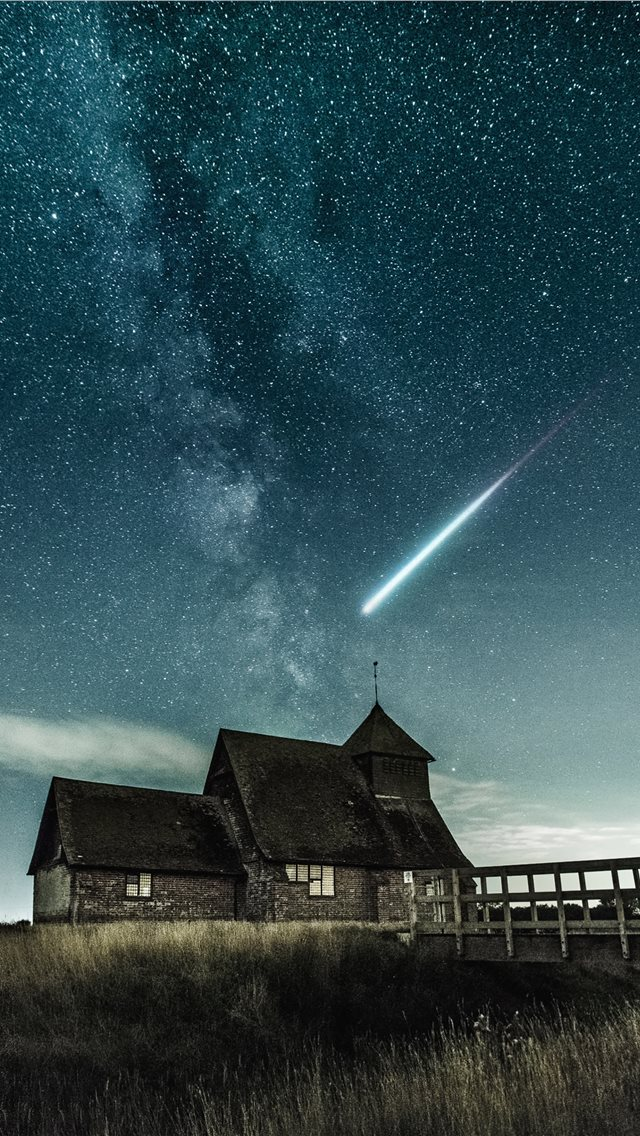 brown house under stary night iPhone wallpaper