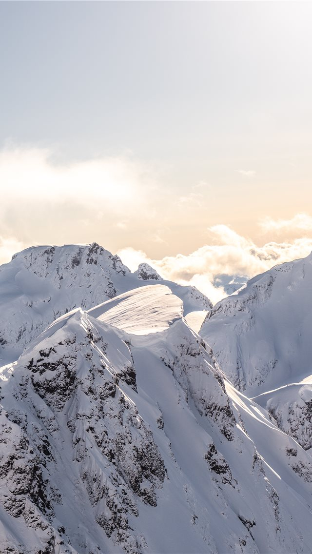 mountains covered by snow at daytime iPhone wallpaper