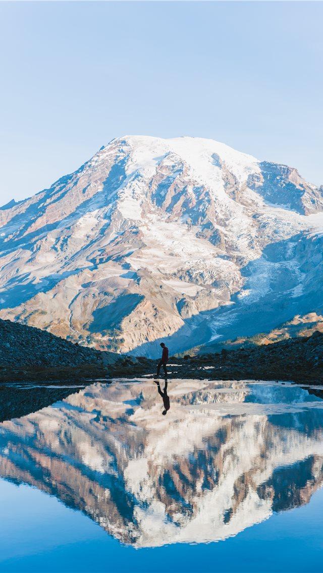 Man Walking Near Glacier Mountain During Day Iphone