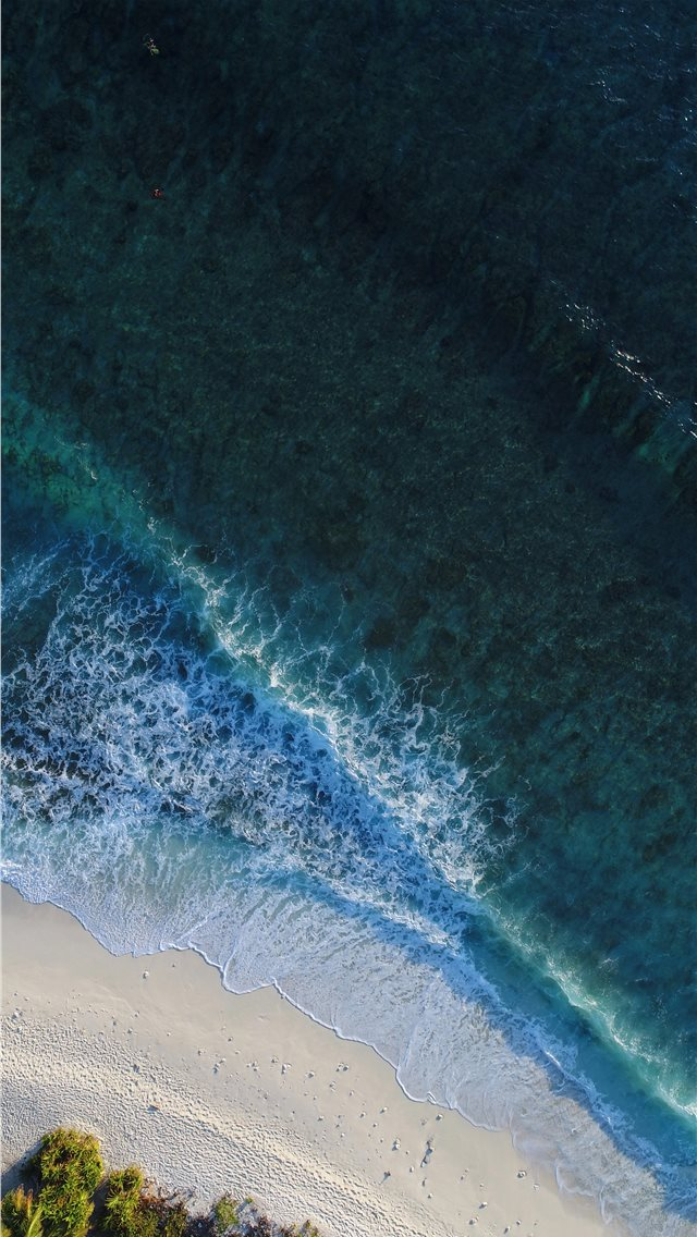 turquoise calm sea wave splashing on white sand be... iPhone wallpaper