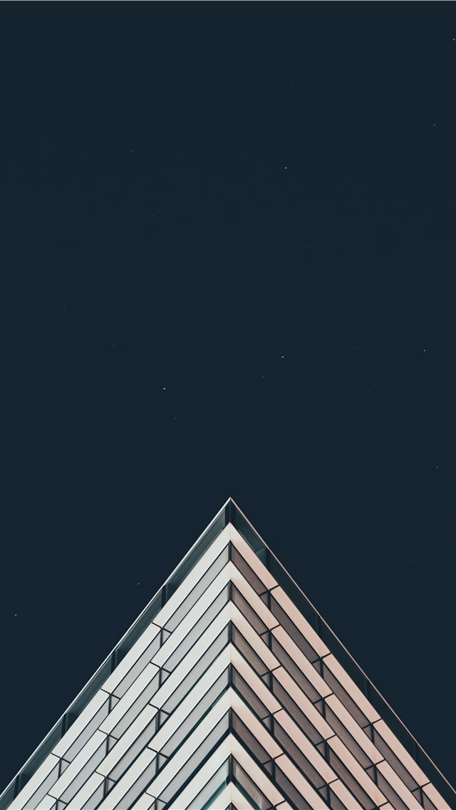 white building under stars iPhone wallpaper