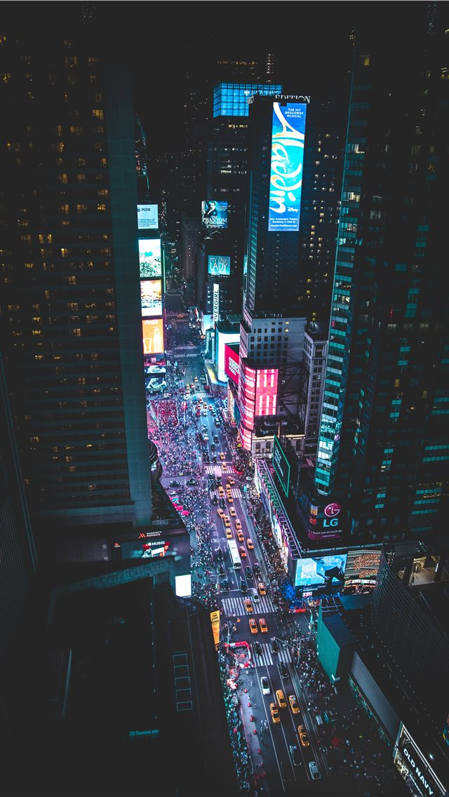 aerial photo of a busy city during night time iPhone wallpaper