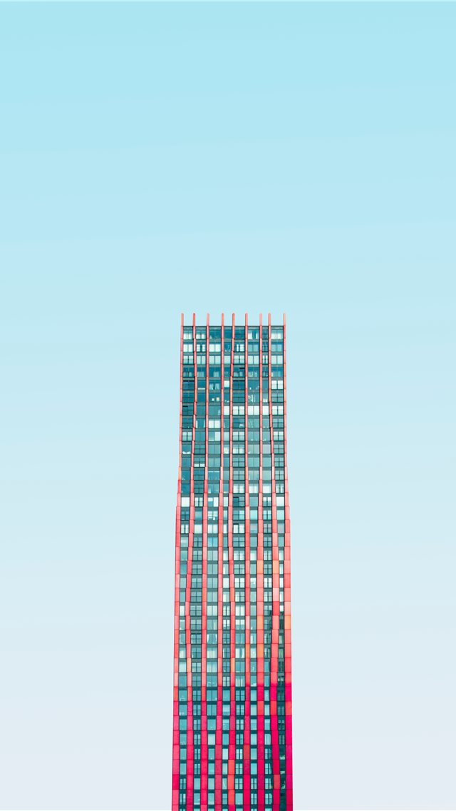 high rise building under blue skies daytime iPhone wallpaper