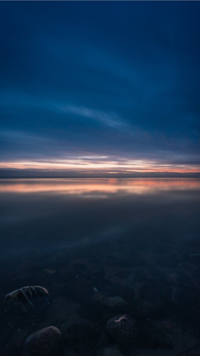 body of water at night iPhone wallpaper