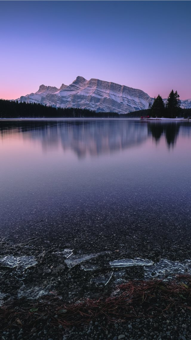 mountain near body of water iPhone wallpaper