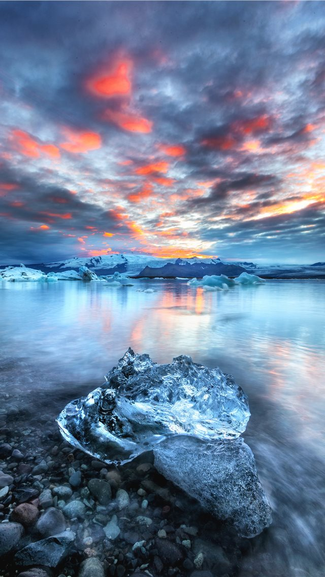 block of ice near water iPhone wallpaper
