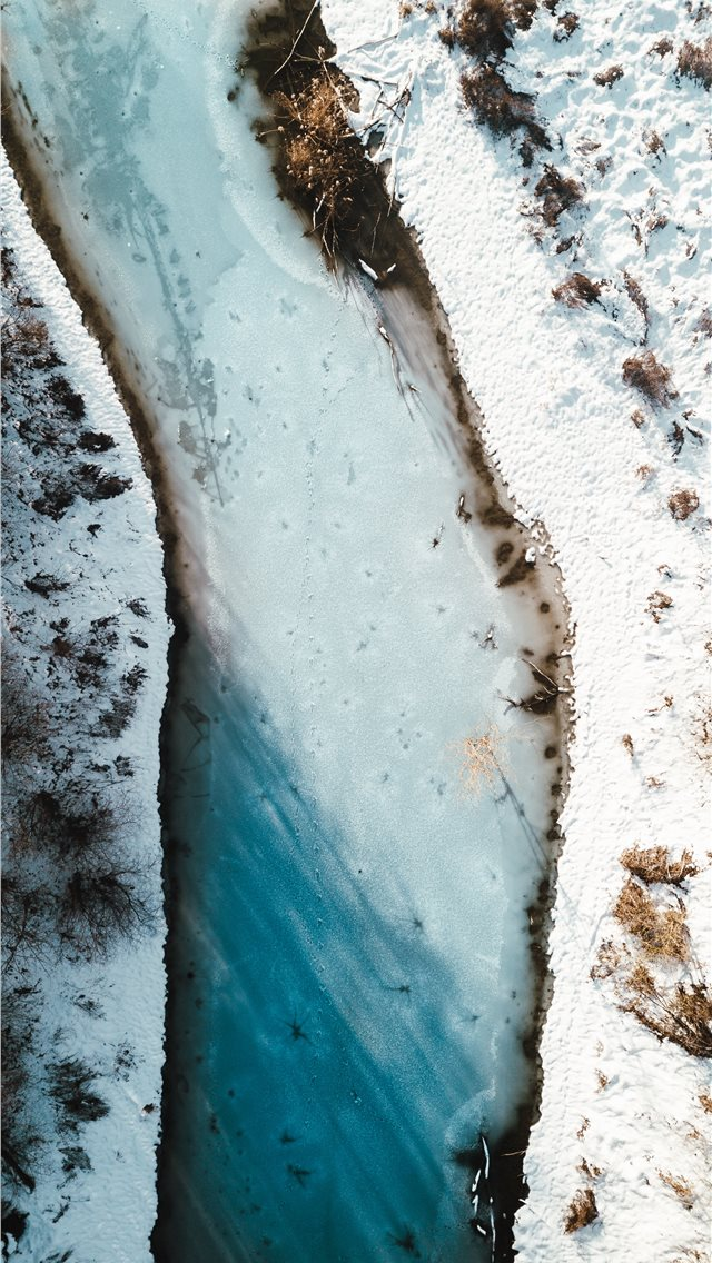 aerial photography of river beside snow field iPhone wallpaper