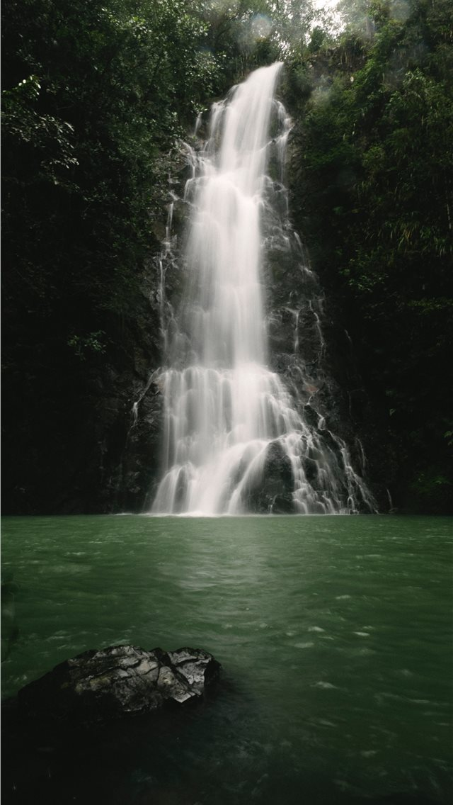 gray rock across waterfalls photo iPhone wallpaper