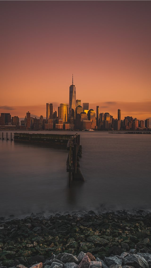 city and body of water during golden hour iPhone wallpaper