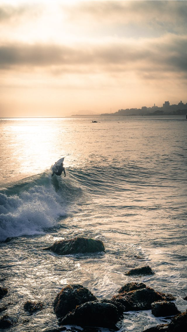 person surfing iPhone wallpaper