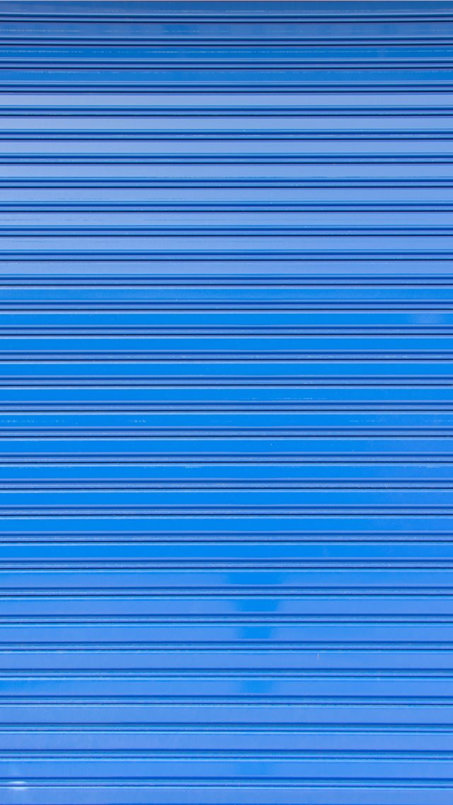 Blue roller shutter of a warehouse iPhone wallpaper