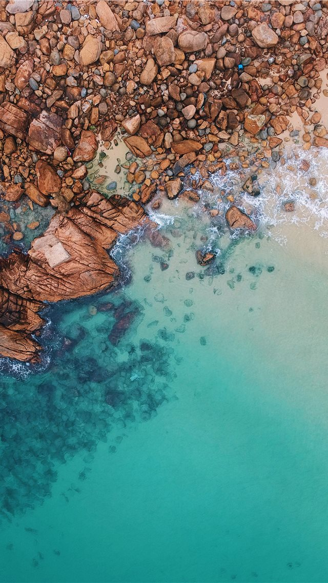 clear blue sea and rocks iPhone wallpaper