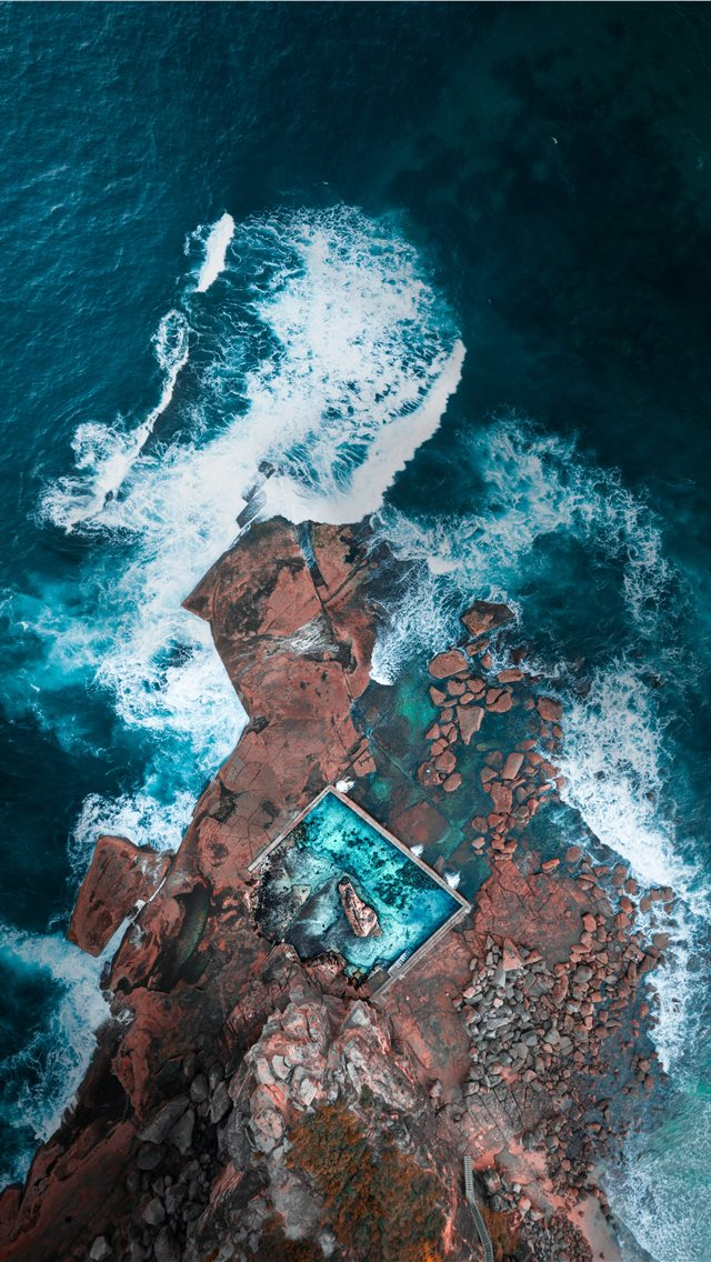 aerial photography of island near ocean iPhone wallpaper