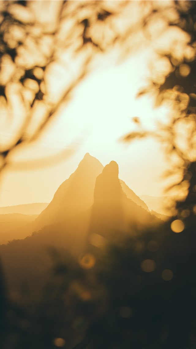 mountains under golden hour iPhone wallpaper