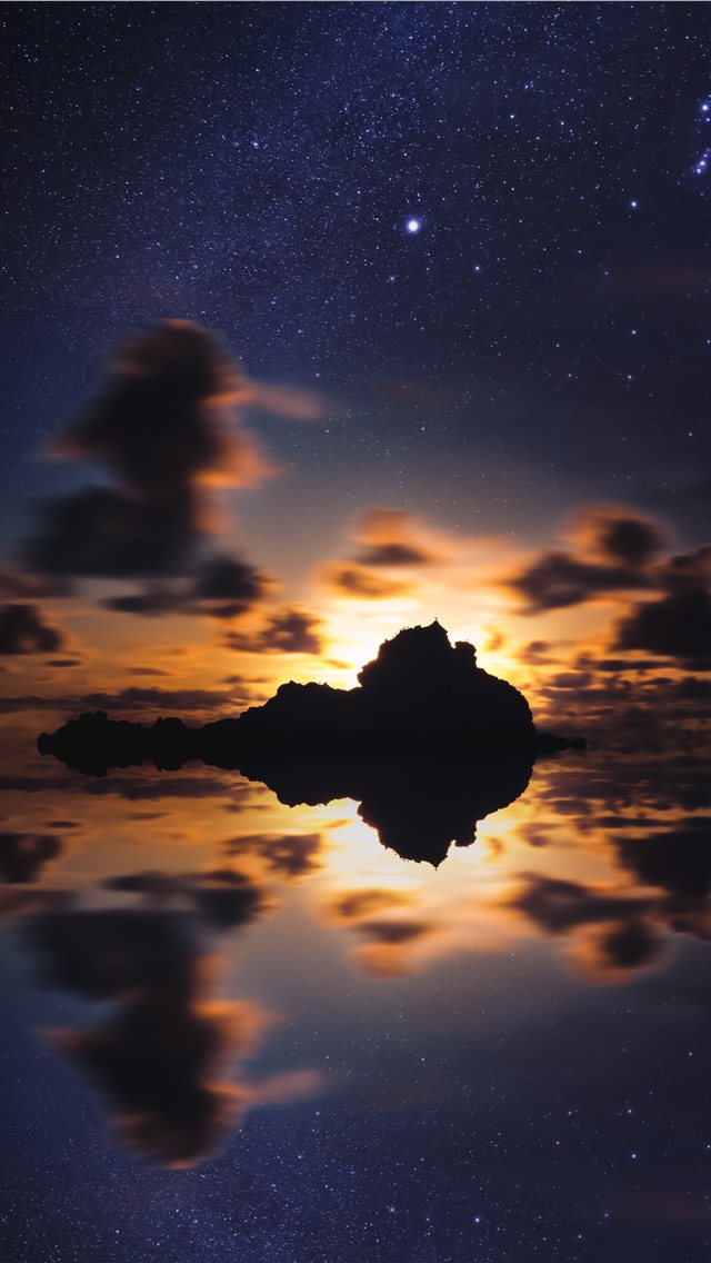 silhouette of islet during golden hour iPhone wallpaper