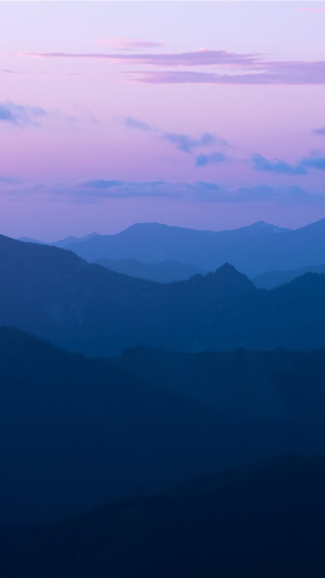 mountain ranges during golden hour iPhone wallpaper