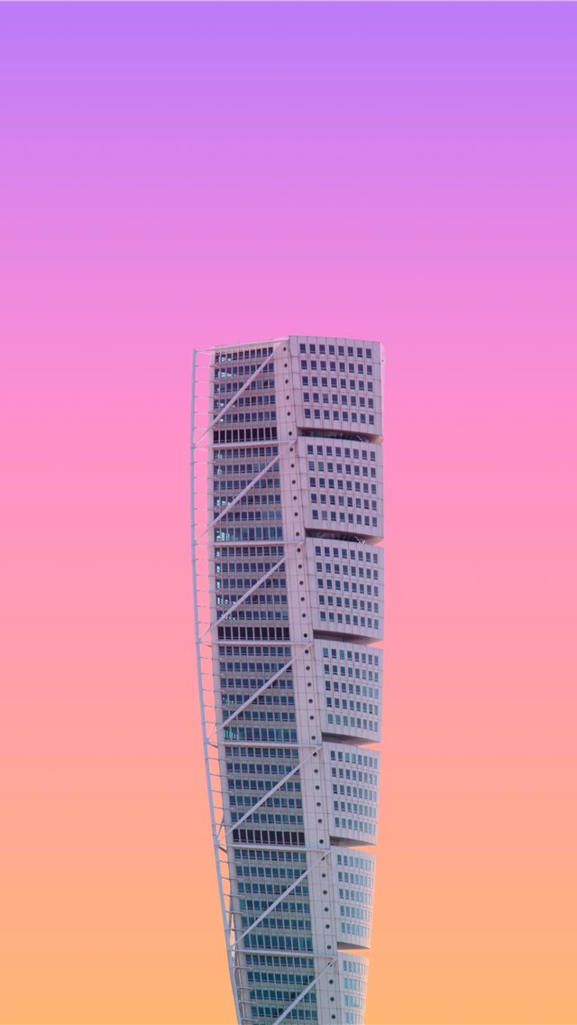 white high rise building under a purple sky iPhone wallpaper