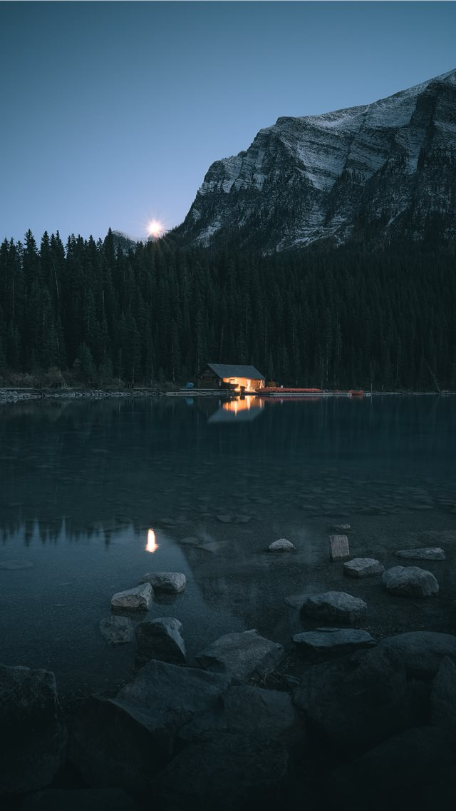 cabin beside lake and trees iPhone wallpaper