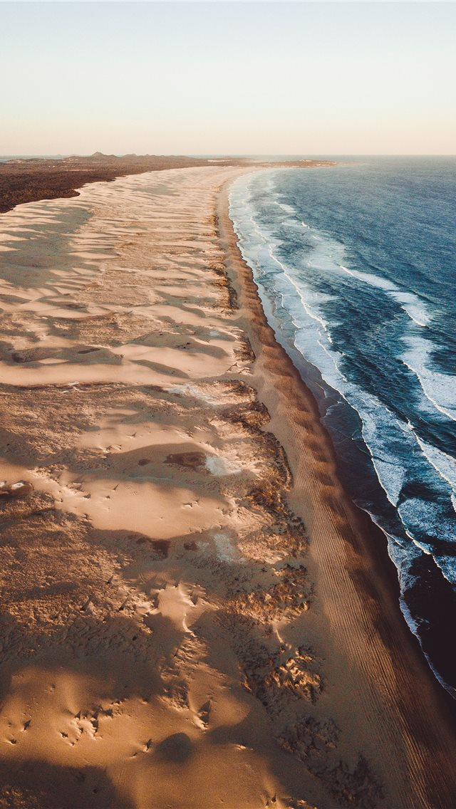 beach during daytime iPhone wallpaper