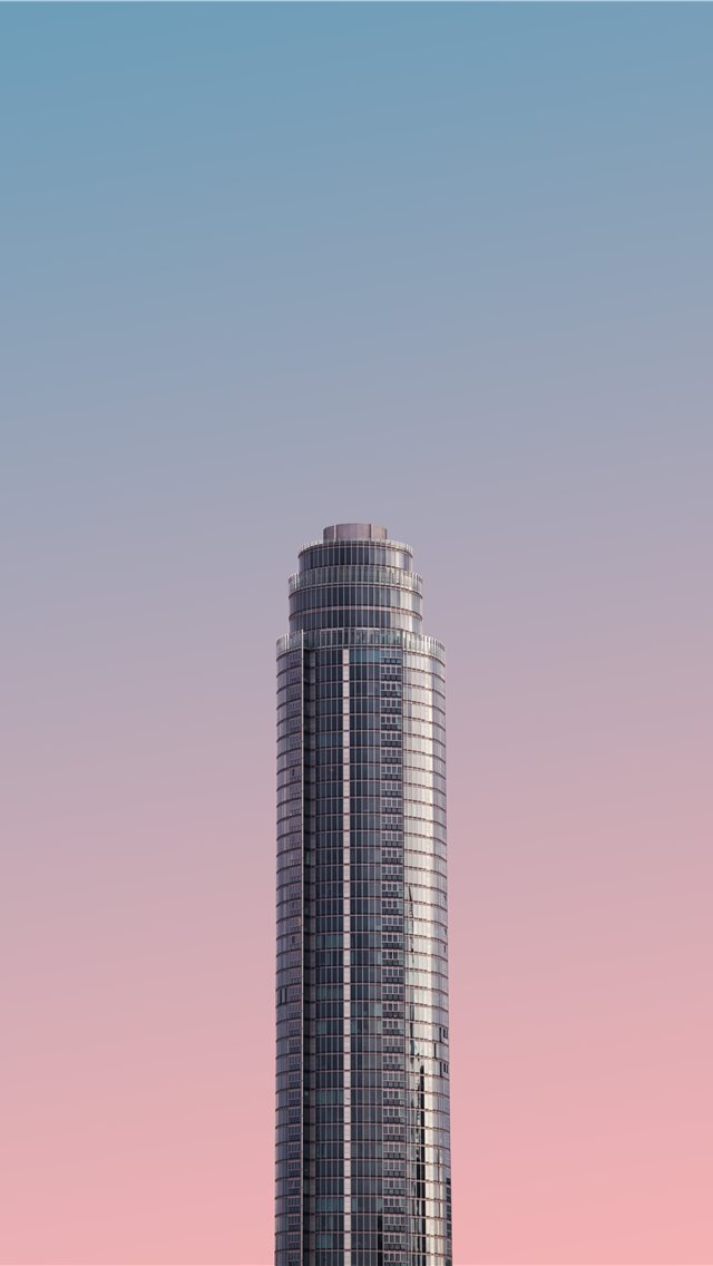 gray tower building under blue sky iPhone wallpaper
